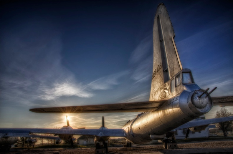 "We say goodbye with this sunset view from behind the B-29 Superfortress ""Hagarty's Hag"""